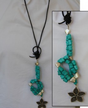 Turquoise and silver in leather necklace